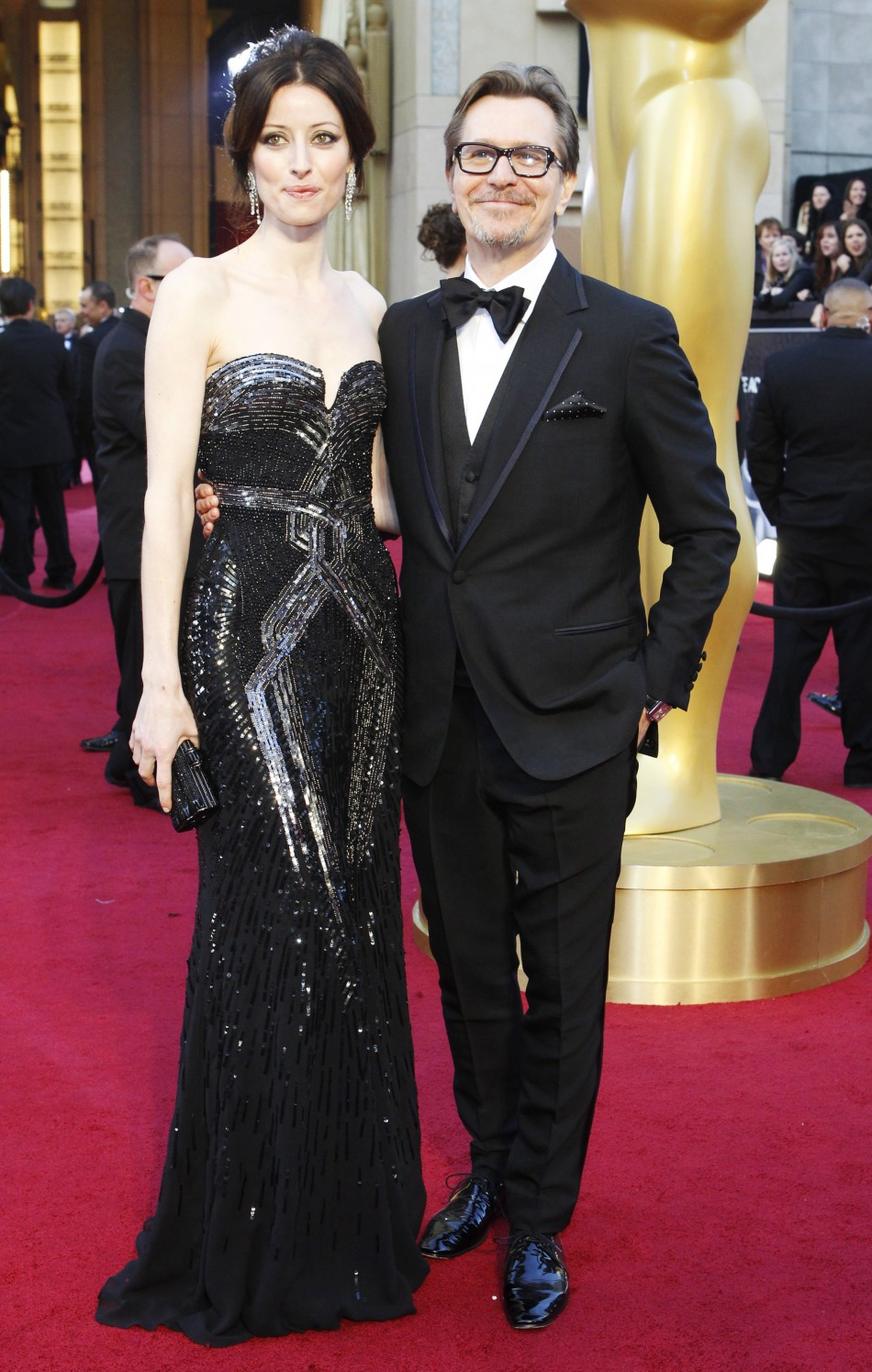 "Gary Oldman, best actor nominee for his role in ""Tinker Tailor Soldier Spy"", and his wife Alexandra Edenborough arrive at the 84th Academy Awards in Hollywood"