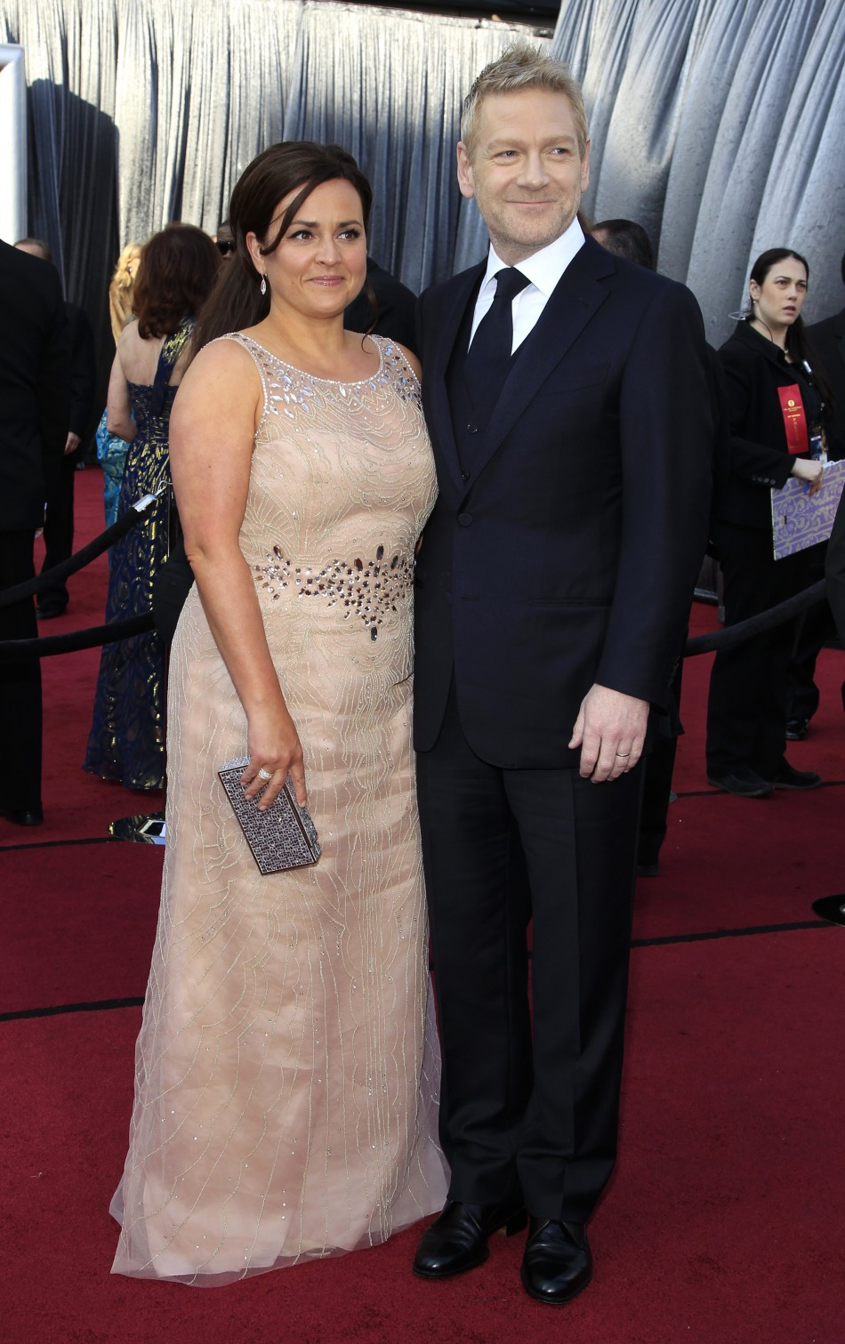 Actor Kenneth Branagh and his wife Lindsay Brunnock pose as they arrive at the 84th Academy Awards in Hollywood