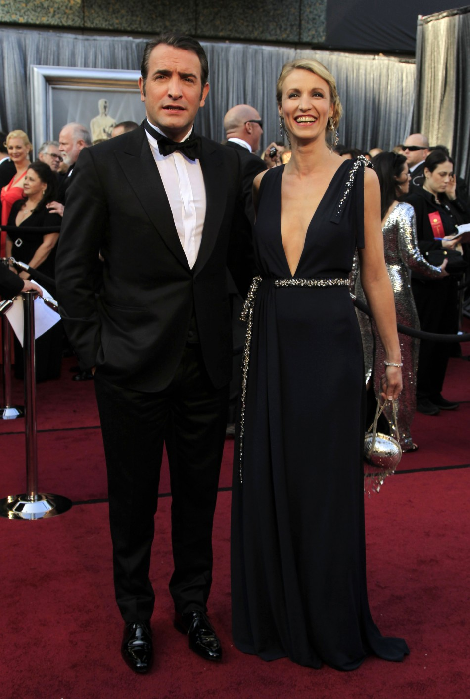 French actor Dujardin and his wife Alexandra Lamy arrive at the 84th Academy Awards in Hollywood