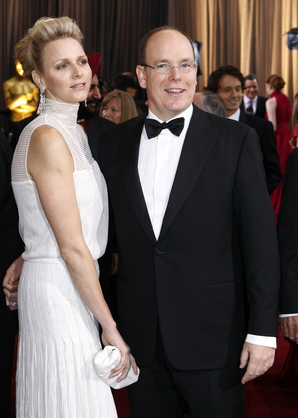 Prince Albert of Monaco and wife Princess Charlene (L) arrive at the 84th Academy Awards in Hollywood