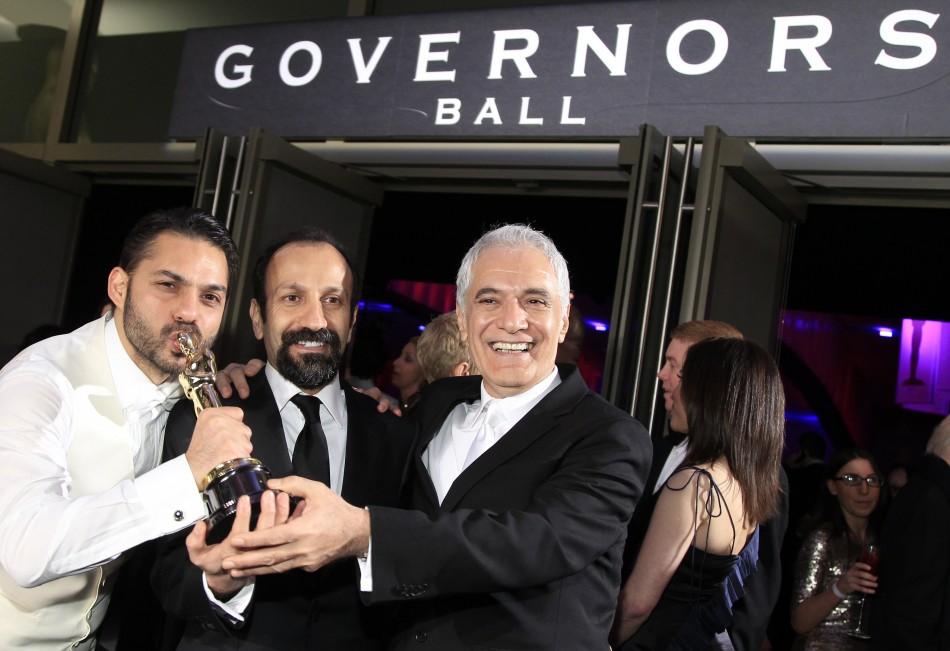 "Asghar Farhadi (C), director of Iranian film ""A Separation"" poses with actor Peyman Maadi (L) and director of photography Mahmoud Kalari"
