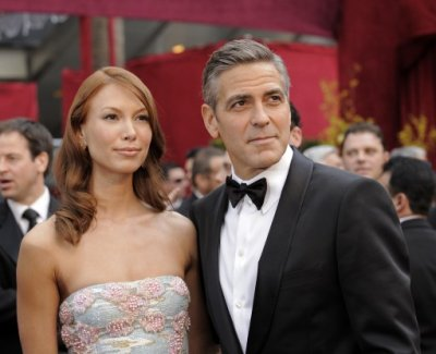 George Clooney arrives with his girlfriend Sarah Larson