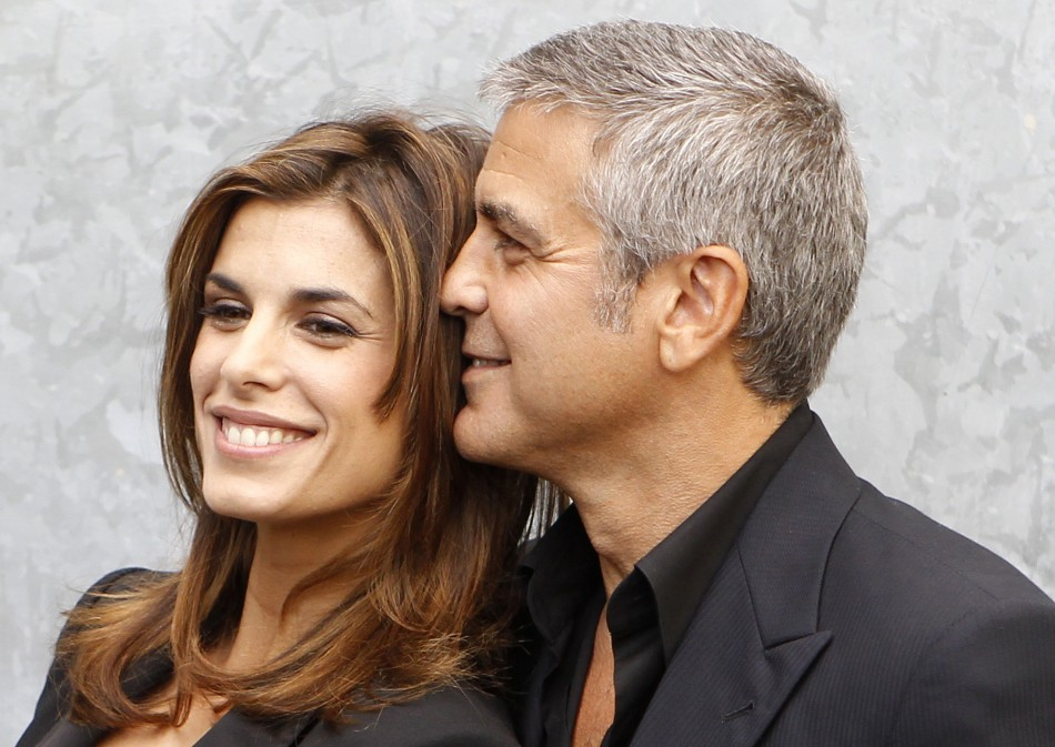 U.S. actor George Clooney poses with his girlfriend Elisabetta Canalis