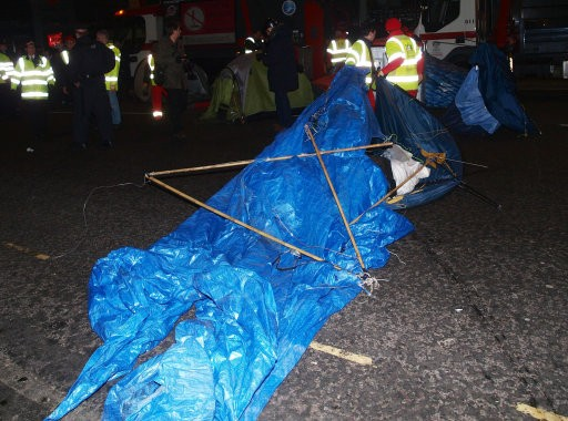 Corporation of London workers remove tents and other structures from the square in front of St Paul039s Cathedral, where anti-capitalist protesters have been camped since November.