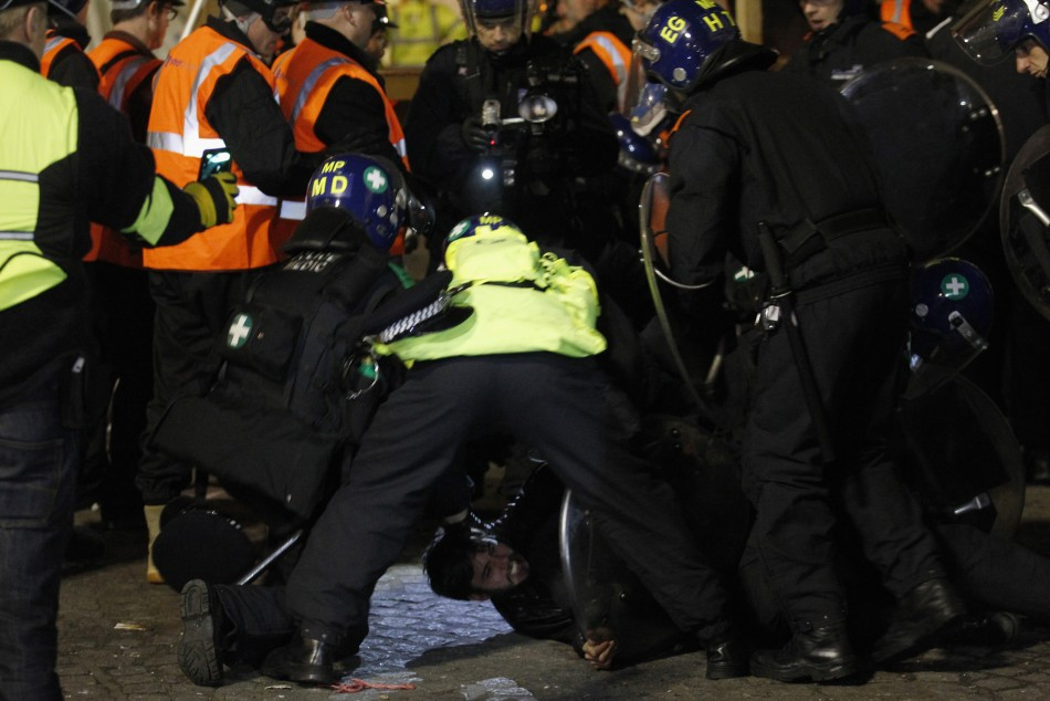 Riot police detain a protester during the eviction of the Occupy encampment outside St Paul039s Cathedral in London