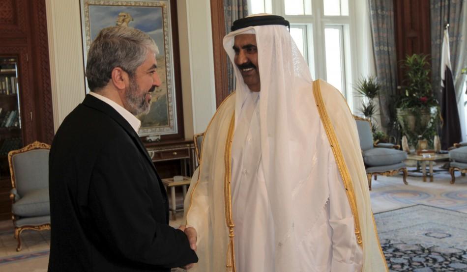Qatar's Emir Sheikh Hamad bin Khalifa al Thani and  Hamas leader Khaled Meshaal before a meeting in Doha