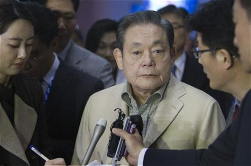 Samsung Electronics Chairman Lee listens to a question from a reporter after touring the Samsung booth at the CES in Las Vegas