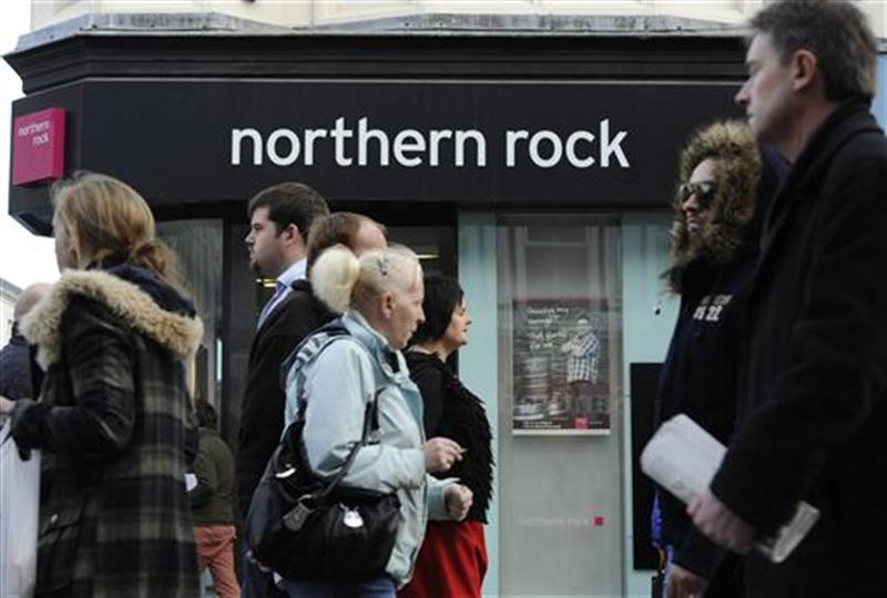 People pass a branch of Northern Rock bank in Newcastle