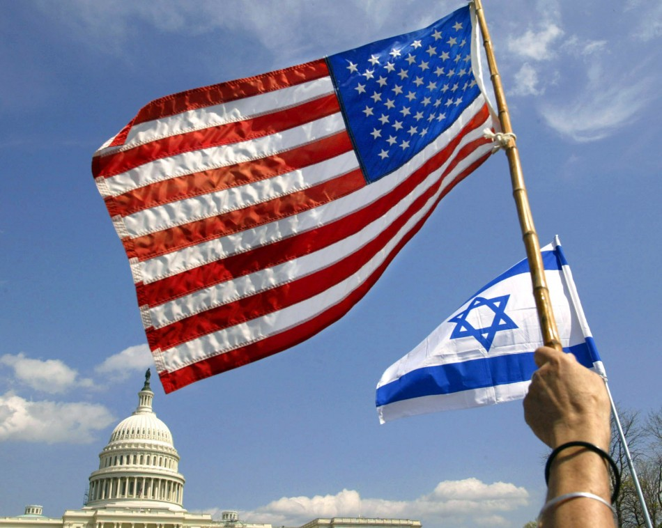 People wave U.S. and Israeli flags