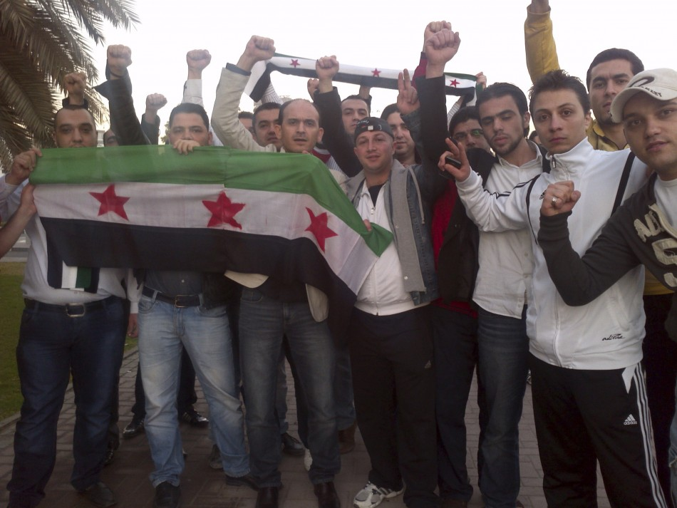 Syrians living in UAE shout slogans against Syrian President Bashar Al-Assad