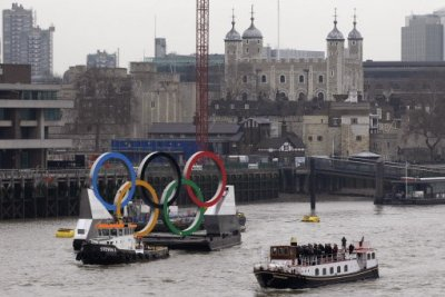 Backdropped by the historic Tower Bridge, a giant Olympic Rings floats on the River Thames in London in the run-up for the Olympic games, during its launch to mark 150-days until the start of the London 2012 Olympic games, Tuesday,