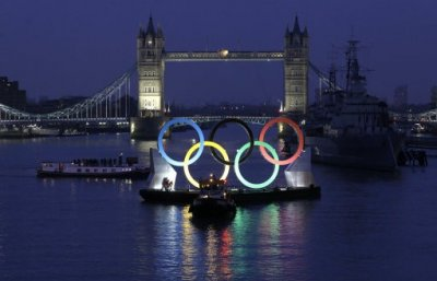 Backdropped by Canary Wharf in the distance, a giant Olympic Rings floats on the River Thames in London in the run-up for the Olympic games, during its launch to mark 150-days until the start of the London 2012 Olympic games, Tuesday