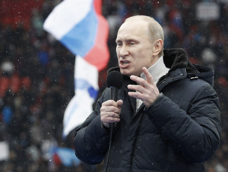 Presidential candidate and Russia's current Prime Minister Vladimir Putin delivers a speech during a rally to support his candidature in the upcoming presidential election
