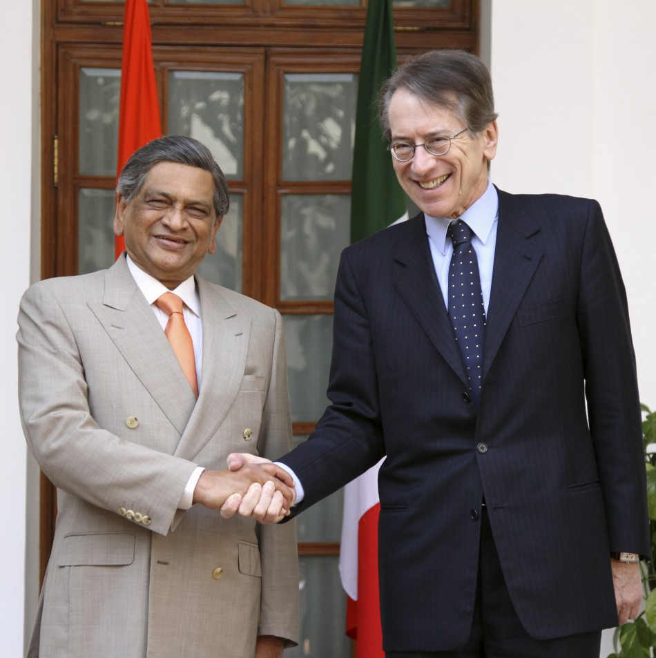 Italian Foreign Minister Terzi shakes hands with his Indian counterpart Krishna