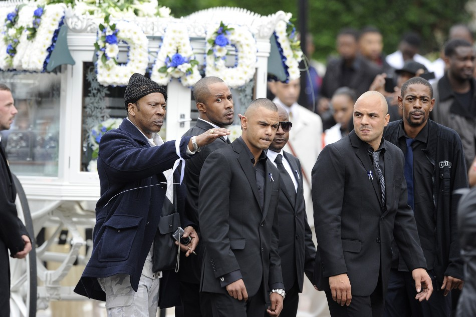 Relatives and friends of Mark Duggan arrive at New Testament Church of God in north London for his funeral