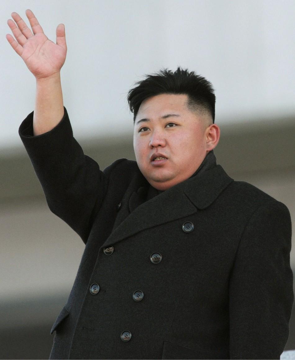 North Korean leader Kim Jong-Un waves during a military parade in Pyongyang