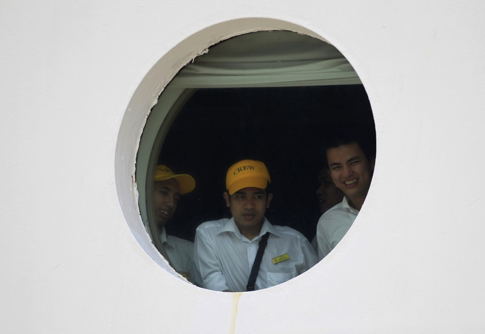 Passengers look out of a window