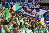 Celtic fans cheer in stands during Old Firm derby