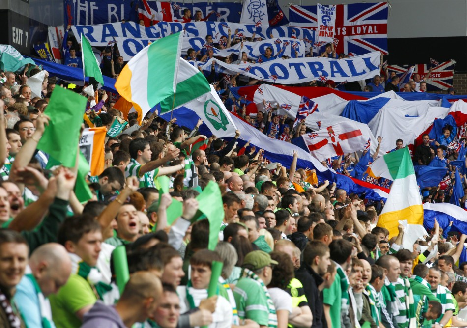 Rangers and Celtic fans cheer in the stands during an Old Firm derby (Reuters)