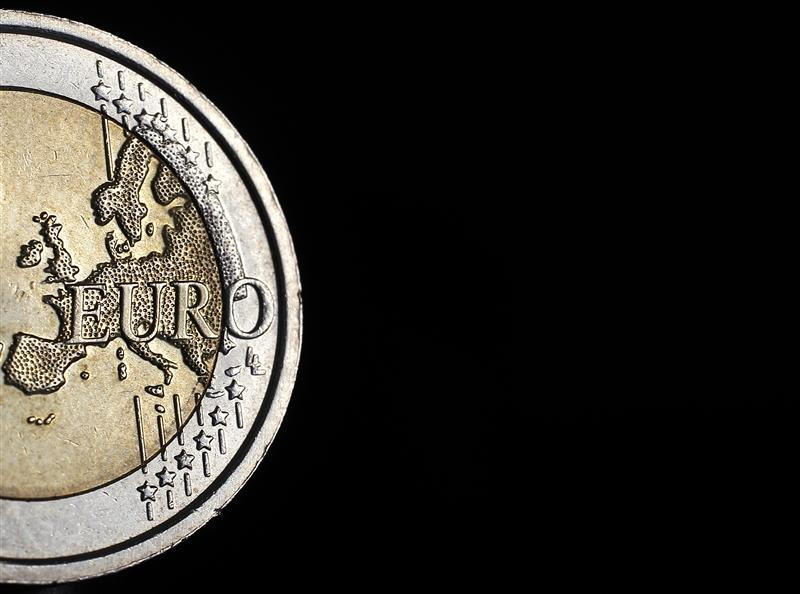 The map of Europe features on the face of a two Euro coin in this photo illustration taken in Rome