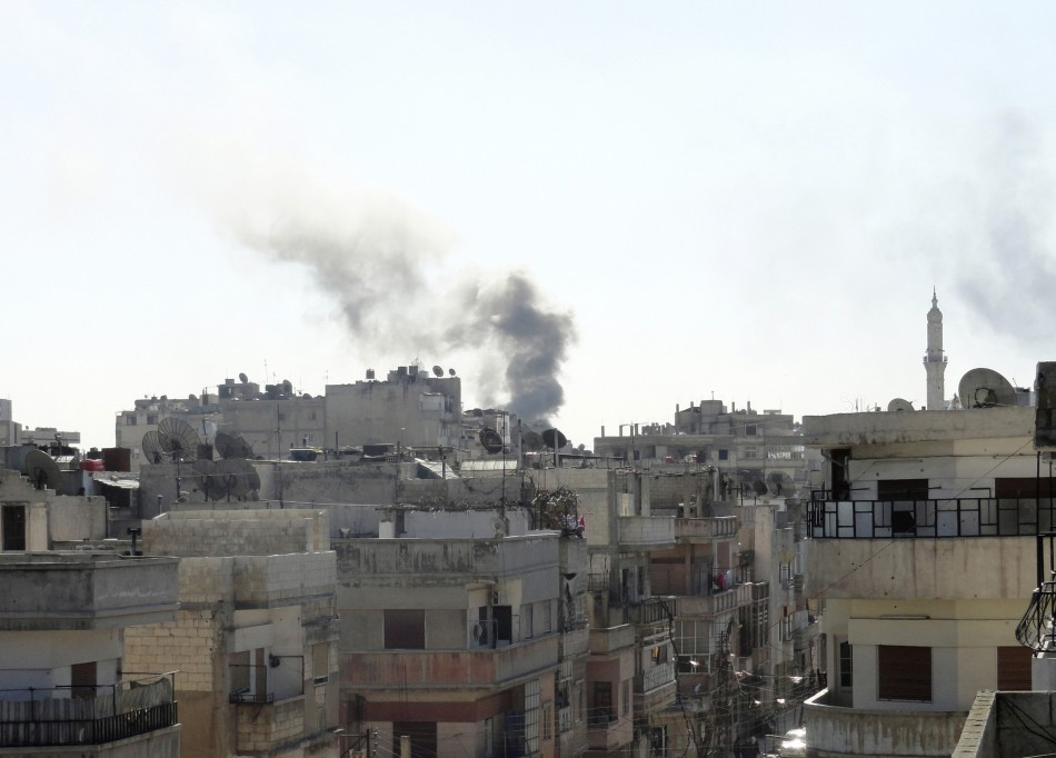 Smoke from shelling rises over the Khaldiyeh area in Homs city