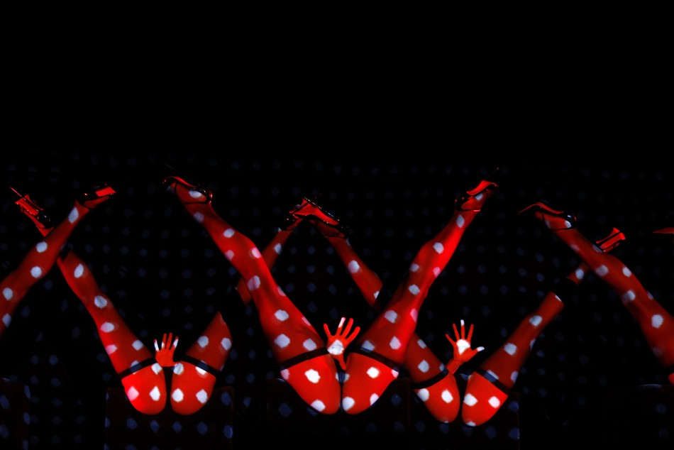 Dancers perform during the press presentation of the new revue named Feu directed by designer Christian Louboutin at the Crazy Horse in Paris