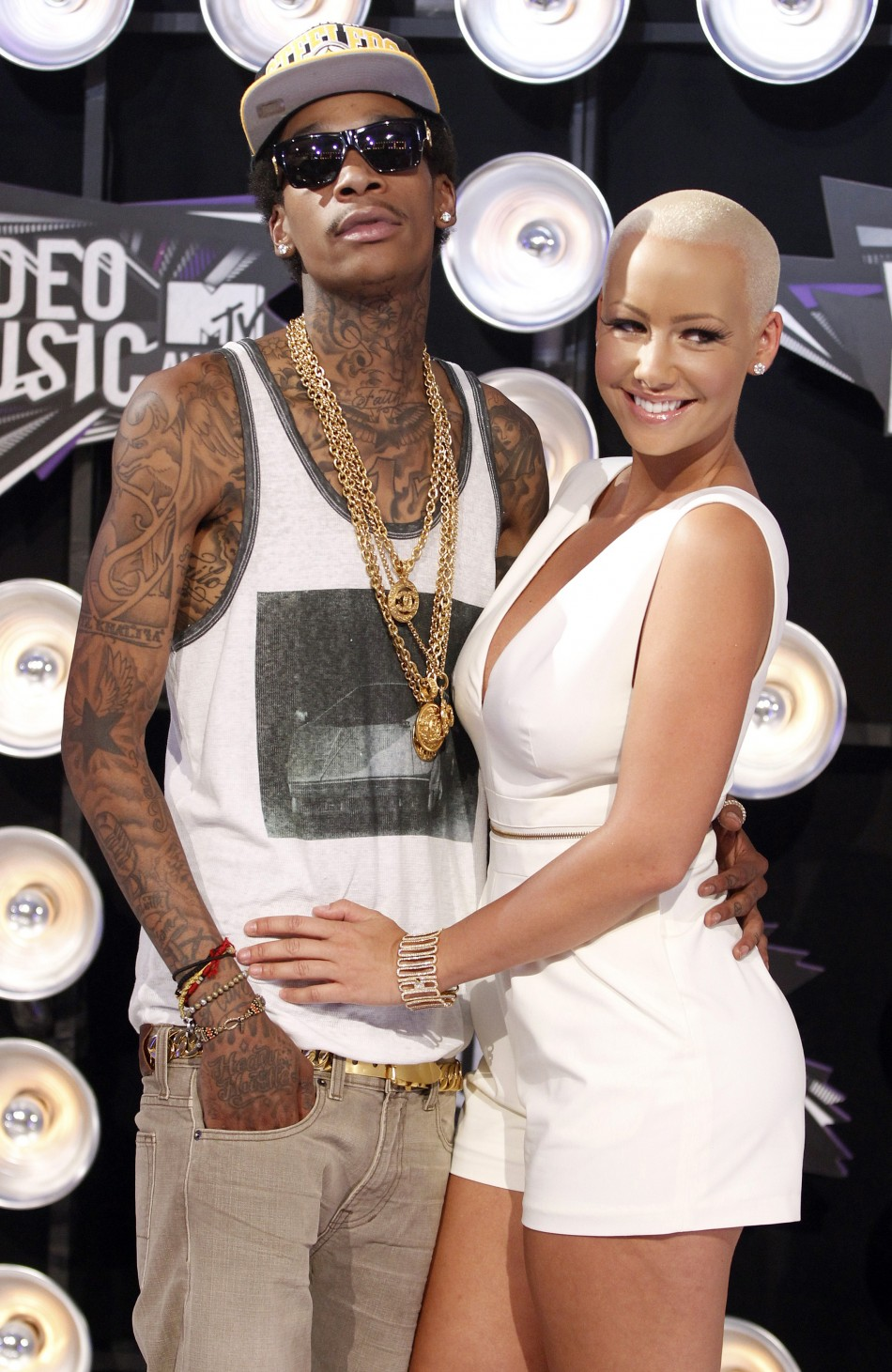 US rapper Wiz Khalifa proposed to model girlfriend Amber Rose and she accepted