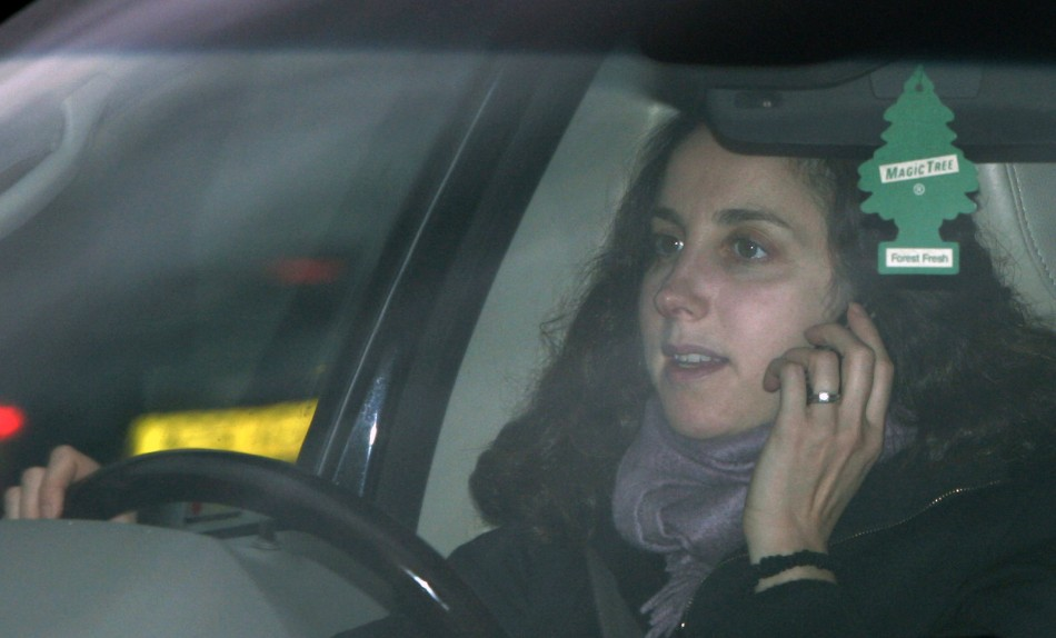 A woman uses her mobile phone whilst driving in London