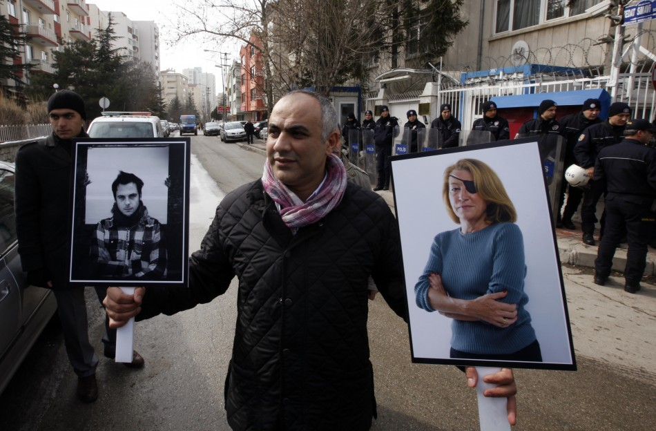 A Turkish journalist attend a demonstration against the killings of journalists in Syria, in front of the Syrian Embassy in Ankara