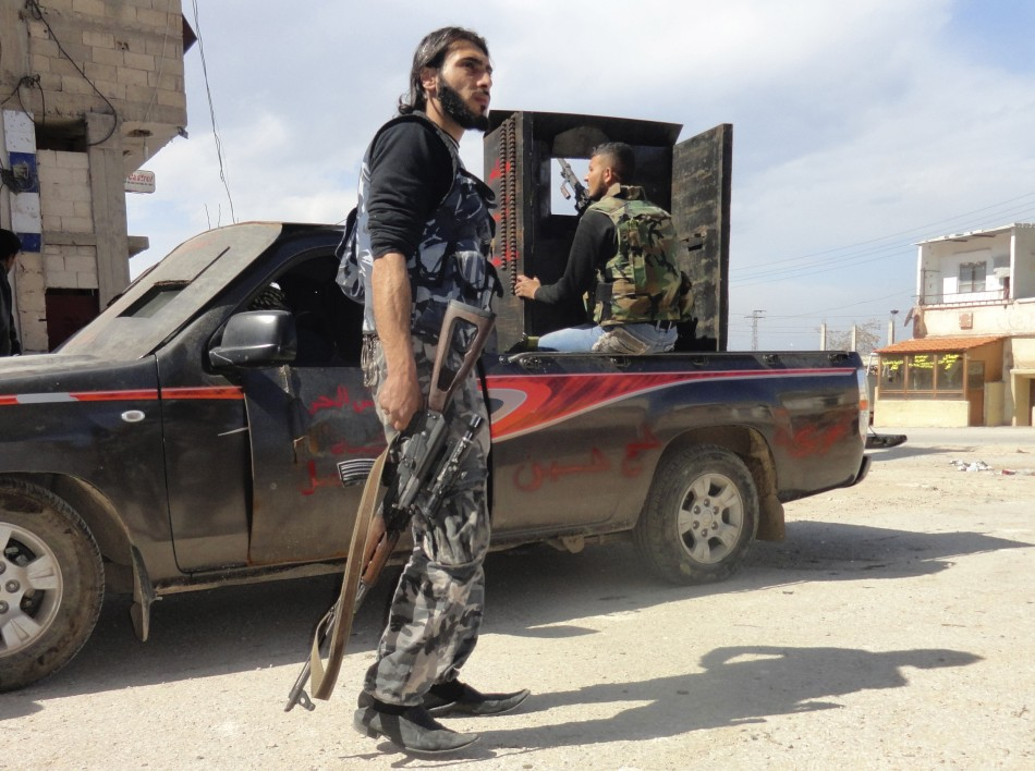 Members of the Free Syrian Army are seen deployed in al-Bayada district in Homs