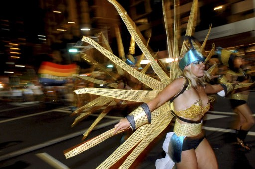Participants perform during the 33rd Sydney Gay and Lesbian Mardi Gras Parade in Sydney, Australia, Saturday, Feb. 27, 2010. Started in 1978 as a protest march for gay rights, the parade attracts hundreds of thousands of spectators to the city to watch th