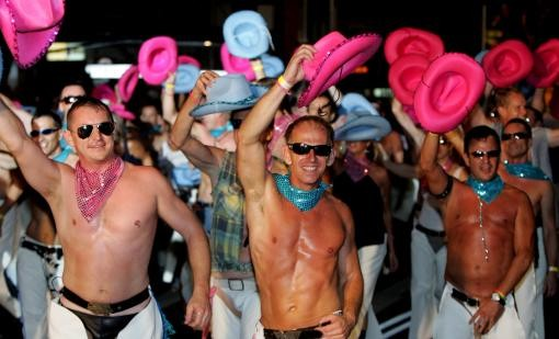 Gay cowboy performers dance during the annual Gay and Lesbian Mardi Gras Parade in Sydney, Australia, Saturday, March 4, 2006