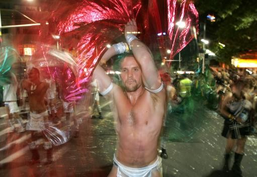 Colorful dancers perform during the annual Gay and Lesbian Mardi Gras Parade in Sydney, Australia, Saturday, March 4, 2006
