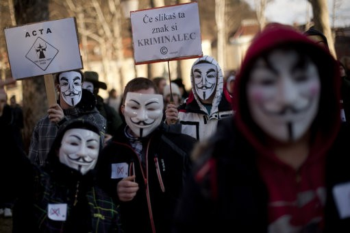 "Internet rights activists wearing ""Anonymous"" masks attend an anti-ACTA protest in downtown Ljubljana, Slovenia"