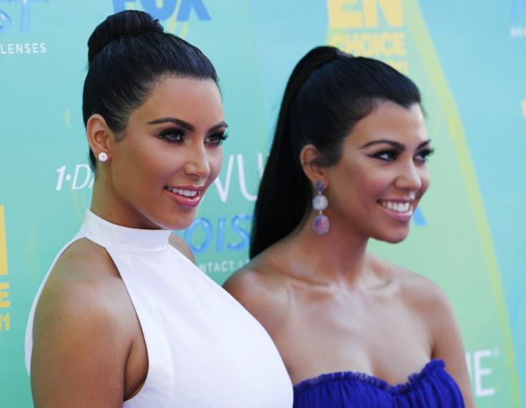 Kim Kardashian (L) and Kourtney Kardashian