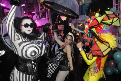 Revellers dance for pictures during the 34th annual gay and lesbian Mardi Gras parade in central Sydney