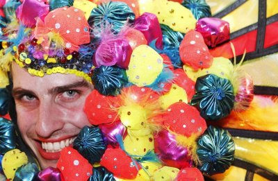 A reveller poses for pictures during the 34th annual gay and lesbian Mardi Gras parade in central Sydney