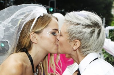 A lesbian couple kiss during the 34th annual gay and lesbian Mardi Gras parade in central Sydney