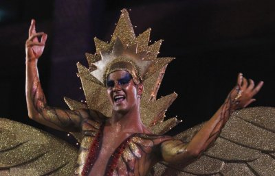A reveller dances during the 34th annual gay and lesbian Mardi Gras parade in central Sydney