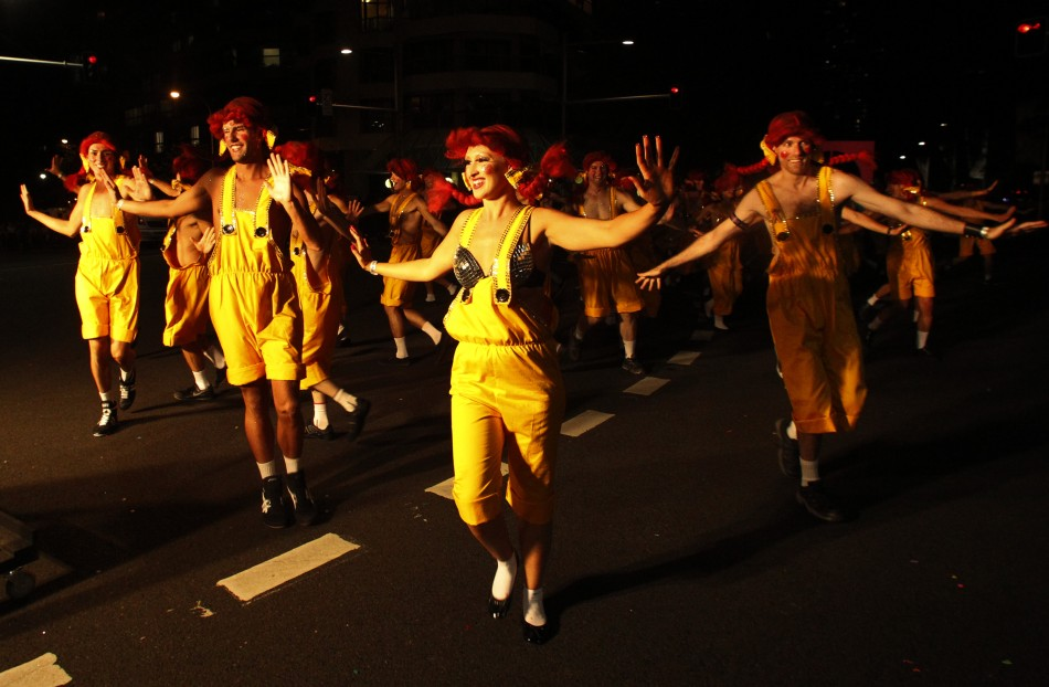 Revellers poses for pictures during the 34th annual gay and lesbian Mardi Gras parade in central Sydney