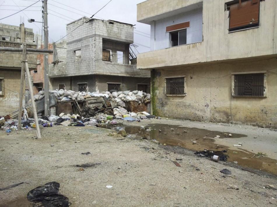 Damaged houses are seen in Karm Al Zaytoon, a neighbourhood of Homs