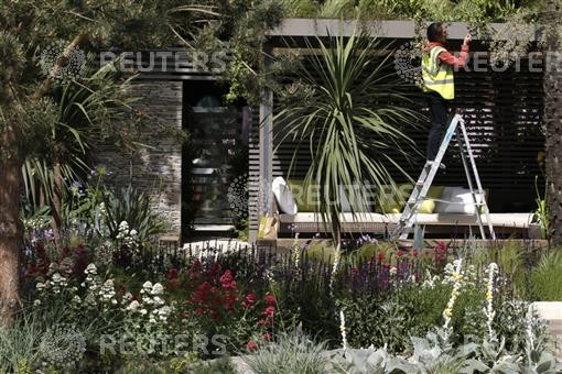 A worker prepares the Cancer Research UK Garden ahead of the opening of the Chelsea Flower Show 2011 on Tuesday in London