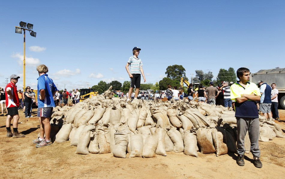 Locals wait for a truck to load sandbags in Wagga Wagga