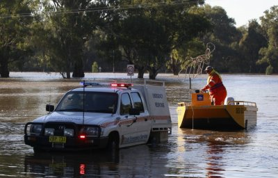 Rainfall poured down by ex-tropical cyclone Oswald has brought flowing to the eastern state of Queensland, Australia, where so far 20 have been rescued.
