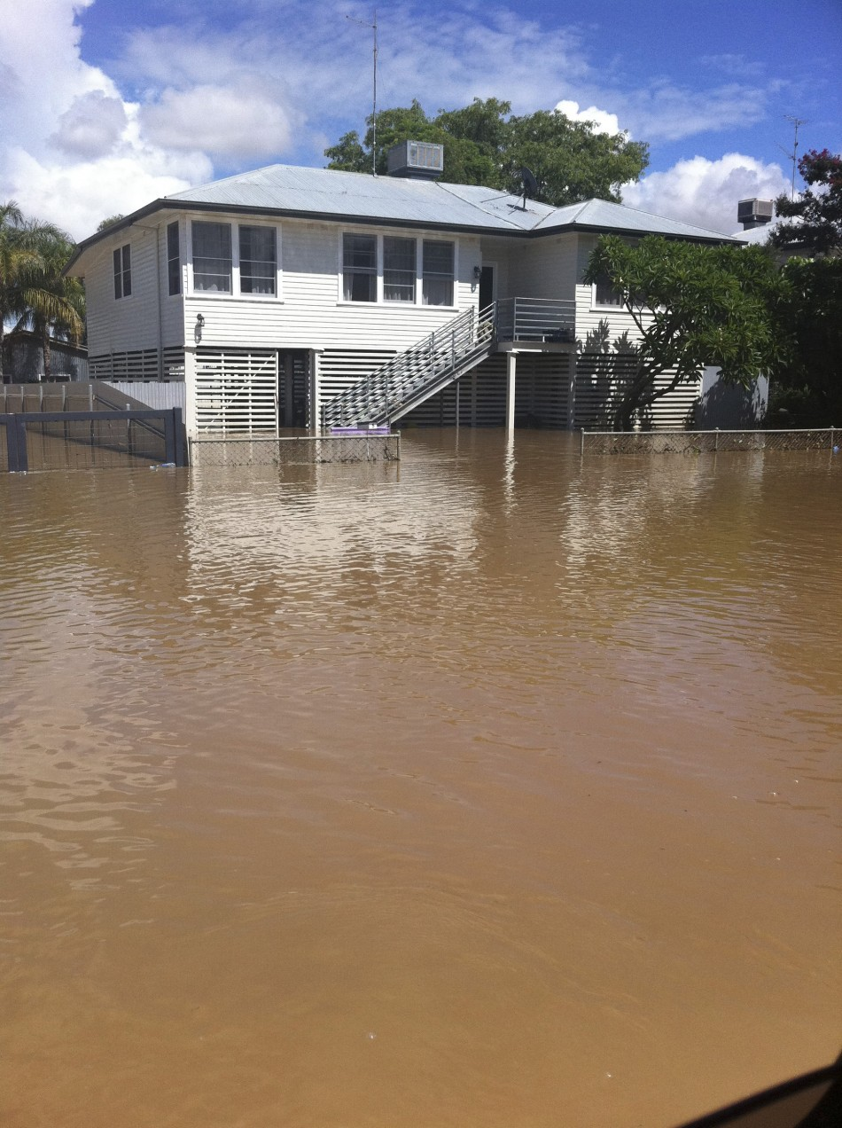 A house is surrounded by floodwaters on a street of the town of Moreeabout 610 km (379 miles) north of Sydney