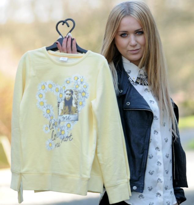 Fashion student Nicola Kirkbride with jumper from Tesco that features her photo