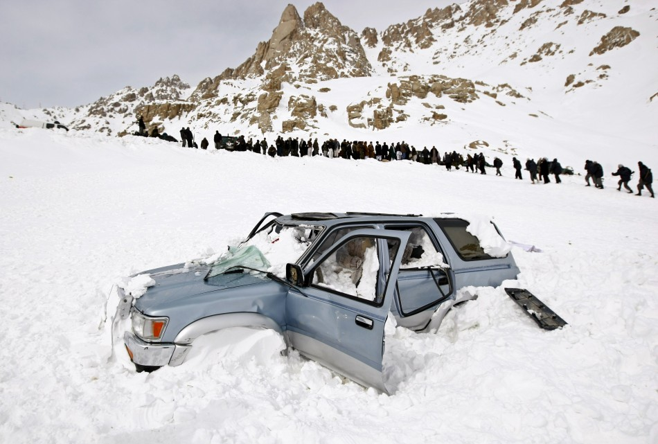 A vehicle is seen covered with snow after avalanches  in Parwan province February 10, 2010. (Reuters)