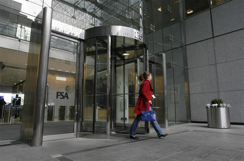 A woman leaves the office in Canary Wharf, London