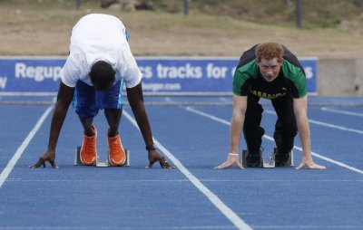 Britains Prince Harry R looks up as he and Olympic gold medallist Usain Bolt start a race