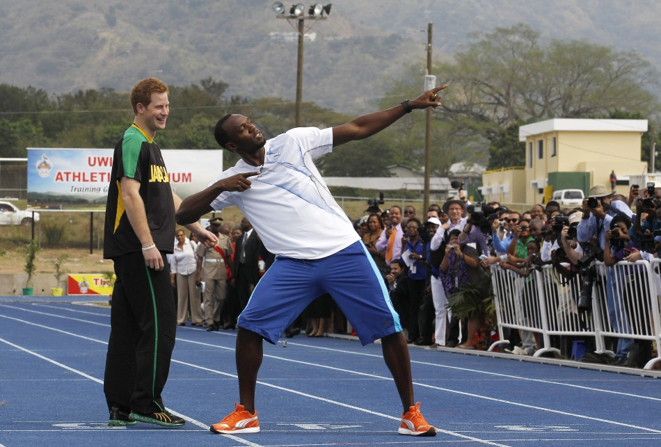 Britain039s Prince Harry L looks on as Olympic gold medallist Usain Bolt poses